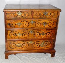 A William and Mary Walnut Chest of Drawers. Circa  1690s. Profusely inlaid with marquetry; the top  and two short and three long graduated drawers  individually decorated with intricate marquetry.  Supported on later bracket feet.  Height  37.25 in. Width 37.25 in. Depth 22.25 in.