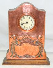 Scarce Art Nouveau Copper Mission Clock. Circa  1900. The hand worked copper case supported on oak  frame and plinth base. 24 x 30 cm.