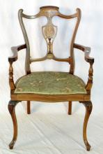 A Choice Edwardian Inlaid Mahogany and Rosewood  Elbow Chair. Early 1900's. Having a finely inlaid  vase shape back and shield shape tapestry seat  raised upon leaf carved front cabriole legs.  Height 35.5in. Width 22.5in.