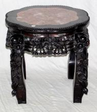A Rare Chinese Hua-Li Wood and Rouge Marble Urn  Stand. Having an octagonal beaded border with leaf  and berry frieze the supports carved in high  relief with flowers and fruit. Height 16in. Width  20in.