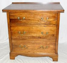 1920s Solid Oak Chest of Drawers.  The moulded top  over 3 large drawers with brass swan neck handles  supported on bracket feet.  Height  33 in   Width   33 inh.  Depth 22 in.