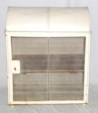 A Vintage Metal Domed Top Food Hutch Safe. Early  1900's. Having a hinged door enclosing a shelf all  supported on four feet. Height 29.5in. Width  23in. Depth 14in.
