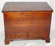 An 18th Century Oak and Inlaid Mule Chest.  Of  small proportions the rectangular top enclosing a  candle box above a pair of inlaid drawers original  brass swan neck handles all supported on bracket  feet.  Height 24 1/2 in. Width 31 in. Depth 18 3/4  in.