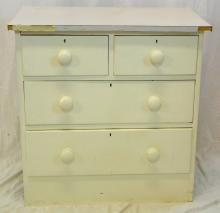 A Victorian Painted Pine Chest of Drawers. Early  1900's. Having two short and two long drawers on a  flat base. Height 33in. Width 32.5in. Depth 19in.