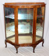 1930s Walnut Serpentine Front Display Cabinet .  Having etched mirror back and 2 glass shelves all  supported on cabriole legs with pad feet.  Height  46 in.  Width 42 in. Depth 13 in.