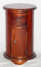A Vintage Cylindrical Mahogany Bedside Cabinet.  20th Century. The deep moulded top over a single  drawer and cupboard supported on a moulded plinth  base.Height 26.5in. Diameter 15.5in.