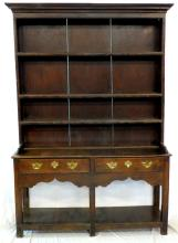 Antique Montgomeryshire Oak and Pine Potboard  Dresser. 18th/19th Century. The boarded rack with  a moulded cornice and  plain freeze over three  shelves. The lower base with two frieze  drawers,ogee pointed arched apron all raised on square supports linked by a pot board. Height  80in. Width 56 1/2 in. Depth 16in.