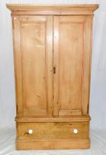 Antique Victorian Pine Clothes Linen Press. Circa  1880s. Cornice top over a deep frieze and two  doors. Internally is a brass hanging rail,7 hooks.  The base has a single drawers supported on plinth  base. Height 75 in. width 42 in. Depth 25 in.