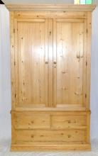 Antique Victorian Pine Clothes Linen Press. Circa  1880s. Cornice top over a deep frieze and two  doors. Internally is a brass hanging rail,5 hooks.  The base has two small and 3 long drawers  supported on plinth base. Height 87 in. width 50 in. Depth 17 in.