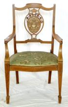 Edwardian Inlaid Mahogany,Rosewood and Satinwood Elbow Chair. Early 1900's. The oval shaped back centred with finely inlaid leaf vase decoration over a serpentine upholstered tapestry seat. All supported on tapering front legs with spade feet, sabre legs to the rear. Height 33 inches