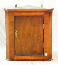 Antique Walnut Hanging Corner Cupboard. 20th.Century. Of small proportions having panelled cupboard door opening to reveal a shaped single shelf. Height 16 in, Width 14 in, Depth 8 Inches.