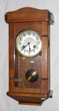 1920s Oak  Cased Wall Clock. 8 Day Chiming on a  Gong. Working order with Pendulum & Key.  Height   19 1/2 inches.