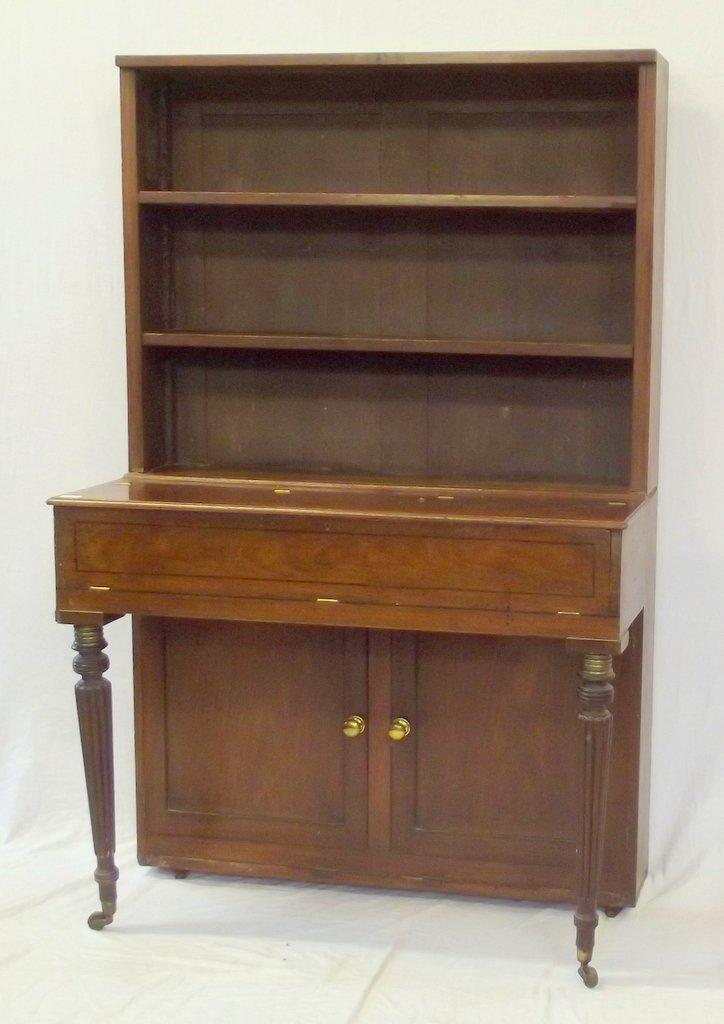 Georgian Mahogany Piano Dresser Converted from a Square Piano. Early 19thc. The top with 3 shelves over the lift up storage compartment with a two door cupboard below. Supported on turned reeded legs to the front. Height 66 in. Width 43 in. Depth 22 in.