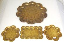 4 Antique Indian Hand Worked Fluted Brass Trays. 19thc. Having engraved gods and figures to the centre. (4 Items)