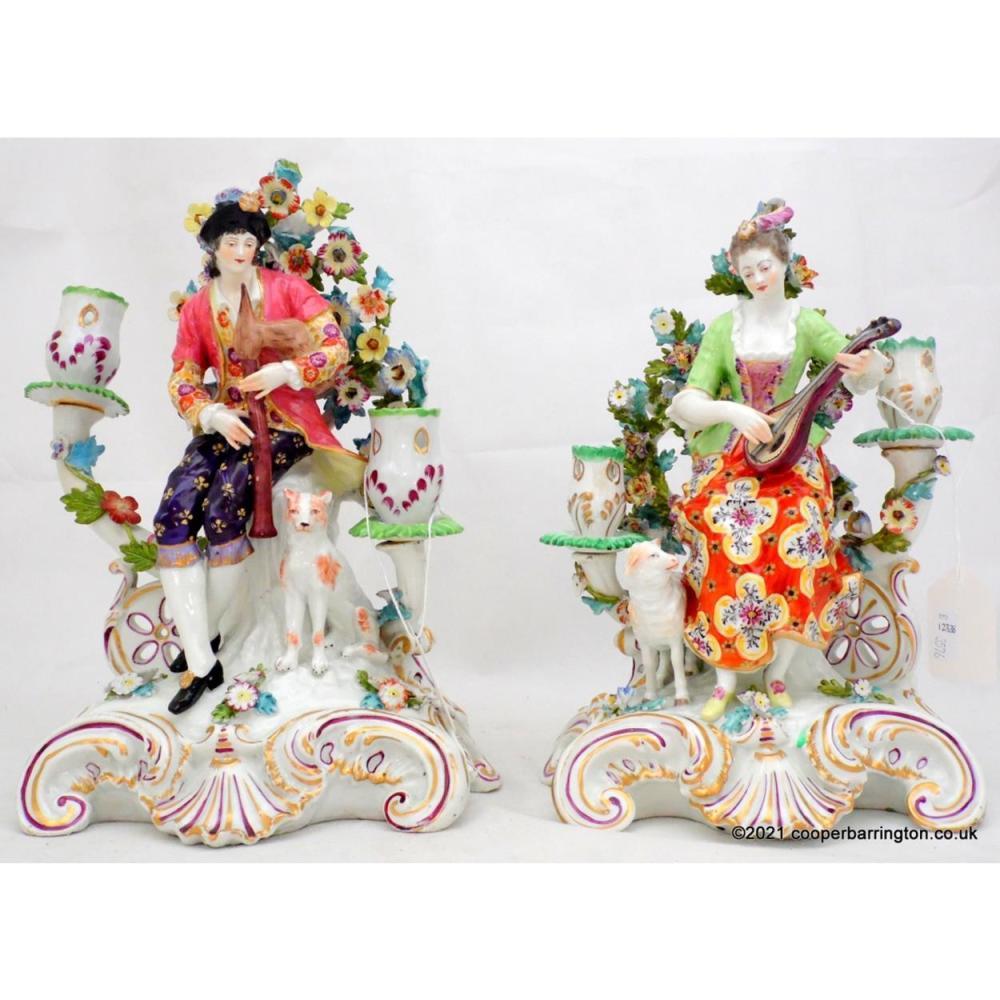 A Pair of Derby Porcelain Candelabra Figures