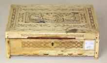 Scarce NAPOLEONIC PRISONER-OF-WAR CARVED BONE LIFT-TOP BOX. Early 19th Century.  Extensive reticulated carving in floral and foliate forms. Central panel on lid depicts men on horseback and another horse/dogs. Height 6.7 cm. Width 21cm. Depth 17 cm. Some missing pieces.