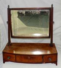 Georgian Mahogany Bowfronted Dressing Chest  Mirror. Early 19thc.  Having the original  bevelled lense over 3 drawers all supported  on bracket feet. Height 22 in.  Width 21 in.  Depth 8.5 in.