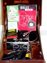 PAILLARD BOLEX H-16 Film Camera 16 mm.  Circa1936/37. Complete in Bolex leather case  with Bolex Guide.