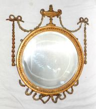 Antique Adam Style Gilt Circular Wall Mirror.  Early 20thc. Decorated with a wonderful urn  to the centre, ornate ribbons swags tails and  rococo beading, original bevelled mirror  plate. 20 x 23 inches.