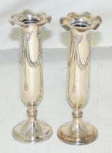 A Pair of Antique Silver Bud Vases. Circa  1900. Having fluted rims decorated with  repousse bows and swag decoration on cast  silver weighted bases. 521 gms.  Height  6  1/2 inches.