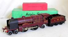 Hornby O Gauge LMS Electric Royal Scot Loco  Tender 6100. In fine untouched, condition  with minor surface wear.Untested.The Royal  Scot with tender measures 16.5 inches (41cm)  long by 3.5 inches (9cm) tall by 2.5 inches (6cm) wide.