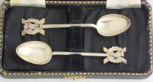 A Pair of Sterling Silver Scottish Saltire  Cross & Thistle Tea Spoons. Marked Sterling.  In original presentation case.