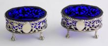 Victorian Sterling Silver Engraved Salt  Cellars with Bristol Blue Glass Liners with  Star Cut Bases by Thomas Hayes. Vacant  cartouch. Hallmarked Birmingham 1902. (2  Items)