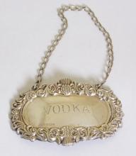 Sterling Silver Engraved Vodka Decanter Label  with Thistle Decoration by W.I.Broadway.  Hallmarked Birmingham. 20thc.  .
