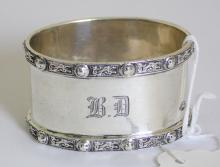 English Sterling Silver Oval Napkin Ring  Monogrammed 'B D' with Norse Dragons  Decoration by Adie Brothers. Hallmarked  Birmingham 1958. 29.3 gm.