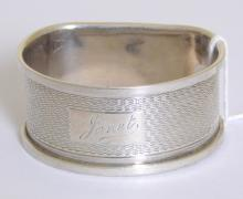 Sterling Silver D Shaped Napkin Ring Having  Engine Turned Decoration & Engraved 'Janet'  by W.I.Broadway.  Hallmarked Birmingham.  20thc.