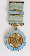 Silver Gilt & Enamelled Masonic Jewel St  Andrew's Lodge 1797 No.222' . Presented to  'Bro J D Mc Neal'.  With silver gilt bar and  ribbon by George Kenning & Son.  Hallmarked  London 1936. Boxed.