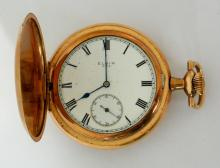 Elgin Pocket Watch Gold Plated Hunter Case  (25 Year).The movement is signed Elgin Nat'l  Watch Co, seven jewels and the serial number  21803941 which dates the watch to  1918.Working order in good condition.