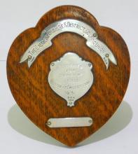 Sterling Silver Mounted on Oak Frame 'The  Caernarvonshire & District Golfing Union'   Memento for Winner of Team Handicap  Competition 1931 Trophy by Solomon  Blanckensee. Hallmarked Birmingham 1930-31.