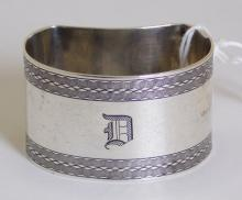 English Sterling Silver Kidney Shaped Napkin  Ring Monogrammed 'D' with Engine Turned  Decoration by E.J.Trevitt & Sons. Hallmarked  Chester 1927. 31.9 gm