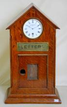 Grand Large W.Thornhill & Co. New Bond St.  London Oak Letterbox Clock. Circa 1890. This  Victorian letter box would have once graced a  grand home, where mail would have been  placed for the Master.The front has an inset 8 Day Timepiece telling household members the  time.  The lock is missing as well as the  postal times/rates framed window. Working  order complete with key.  Height 19 in. Width  11 in.  Depth 6 3/4 in.