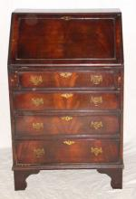 A George III style mahogany bureau, the  hinged fall front enclosing a fitted  interior, above 4 long drawers on bracket  feet. Height 38.5in. Width 24in. Depth 16in