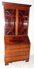 An Edwardian Inlaid Mahogany Bureau Bookcase.  Having a cavetto cornice on a satinwood  inlaid freeze above a pair of astral glazed  doors. Below the bureau with hinged fall  enclosing a fitted interiour above 4 long graduated drawers on bracket feet. Height 82  in. Width 36 in. Depth 19 in.