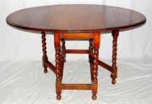 1920s Oval Oak Barley Twist Gateleg Dining  Table.  Height 29 in. Length 20-53 in. Width  36in.