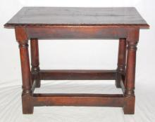 Antique Period Oak Centre/Side Table. 18thc.   The 4 plank top with carved moulded edge  supported on gun barrel legs linked with  cross stretchers.  Height 31 in.  Length 41  in. Width 24 in.