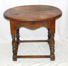 Antique Oak Oval Side Table. Early 1900s, Turned Supports and Cross Stretchers. Height 25in Width 27.5in Depth 19 inches.