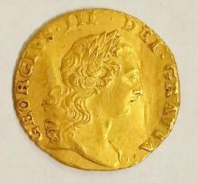 Great Britain. George III.Gold Quarter Guinea, 1762. S.3741; Fr-368; KM-592.  Laureated head right. Reverse: Crowned arms. Creased. 2.1 gm.