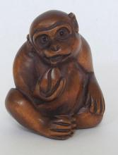 Antique Japanese Wood Carved Netsuke of a Monkey. Signed to base. Early 1900s.
