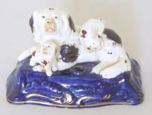 Rare Victorian Spaniel Group Quill Holder. Early 19thc.  Featuring parent spaniel and pups on cobalt base. Height 2.75 inches.