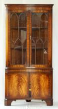 Vintage Concave Front Bevan and Funnel 'Reprodux' Flame Mahogany Corner Display Cabinet. 20thc.  Having astral glazed doors over 2 cupboards on bracket feet. Height 74 in. Width 35 in.  Depth 20 in.