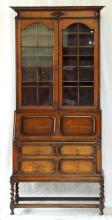 Antique Jacobean Style Oak Bureau Bookcase. Early 1900s. The astral glaze top with 3 adjustable shelves over a fitted desk interior having drop down front writing surface with 2 further storage drawers below supported on barley twist legs.  Height 82.5 in. Width 36 in. Depth 16 in.