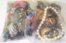 Good Collection of Unsorted Costume Jewellery in Two Sealed Bags . 5.7 kg.
