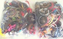 Good Collection of Unsorted Costume Jewellery in Two Sealed Bags . 5.5 kg.