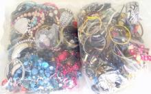Good Collection of Unsorted Costume Jewellery in Two Sealed Bags . 5.6 kg.