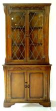 Old Charm Style Carved Oak Lead Glazed Corner Cabinet. 20thc.  Height 70in.
