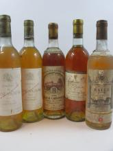 5 bouteilles 2 bts : CHÂTEAU RAYNE VIGNEAU 1985 1er cru Sauternes (haute épaule, étiquettes abimées, capsules très abimés)